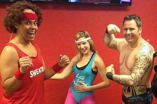 KABB-TV morning and noon anchor Ernie Zuniga won the prize for Best Costume in 2014 with his dead-on impression of crazy exercise guru Richard Simmons. He got excellent support from co-anchor Jessica Headley as 'Let's Get Physical's' Olivia Newton-John and Shaun Stevens as a WWE wrestler.