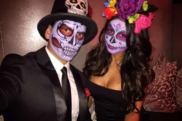 KABB's evening anchorman Ryan Wolf went to the spooky side with his Dia De Los Muertos-inspired costume for Halloween; his wife mirrored his creepiness.