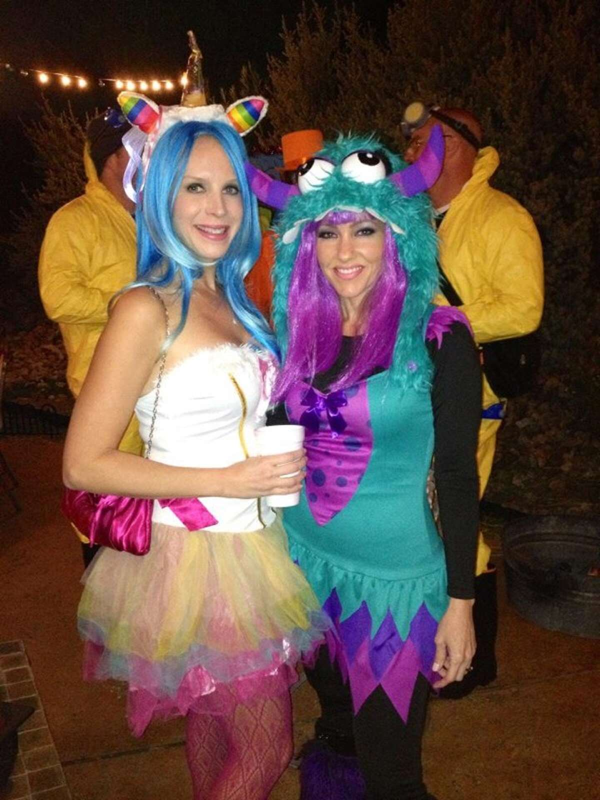 WOAI anchorwoman Delaine Mathieu (right) would fit right in on Sesame Street in this bright, fuzzy Halloween concoction. Her pal (left) went as a unicorn.