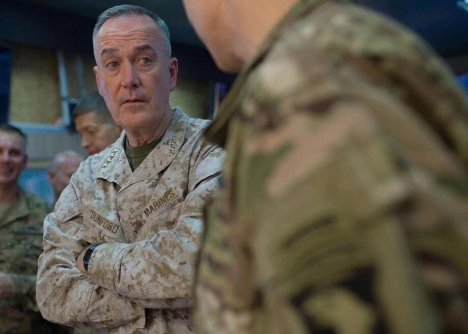 """Marine Gen. Joseph Dunford Jr., chairman of the Joint Chiefs of Staff, receives a campaign update from a U.S. service member near Erbil, Iraq, during an August visit to Iraq and Turkey to assess the campaign against the Islamic State. GOP presidential candidate Donald Trump has described the nation's senior military leaders as """"rubble."""" Dunford is not rubble. Photo: Navy Petty Officer 2nd Class Dominique Pineiro / Handout"""