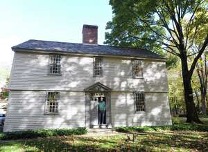 Bob Simms in the doorway of his landmark home at 213 Round Hill Road in Greenwich. The main house has its origins as a 1700 saltbox from Hadley, Massachusetts, that was moved to its current location in Greenwich in the 1950s.