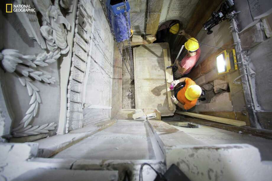 In Jerusalem, workers remove the top marble layer of the tomb said to be of Jesus Christ. Experts said the marble slab was last moved in 1550. Photo: Dusan Vranic, STF / National Geographic