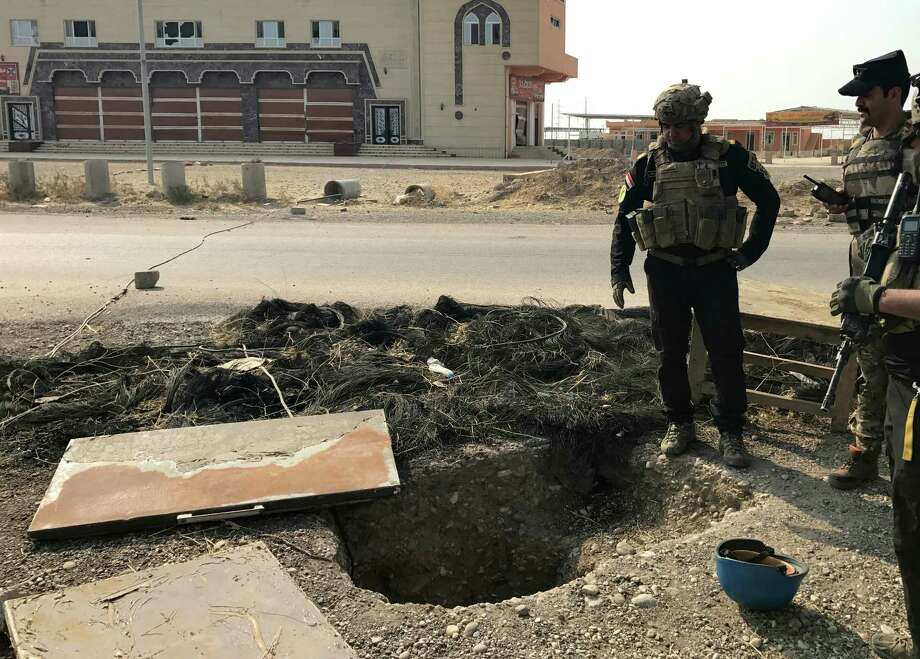 A soldier with Iraq's elite counterterrorism force inspects a tunnel made by Islamic State militants in Bartella, Iraq, on Thursday. The town of Bartella is east of Mosul. Photo: Ali Abdul Hassan, STF / Copyright 2016 The Associated Press. All rights reserved.
