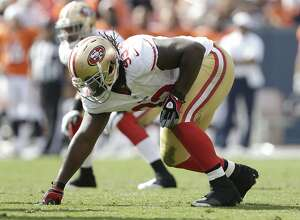 FILE - In this Aug. 26, 2012, file photo, San Francisco 49ers nose tackle Ian Williams (93) lines up against the Denver Broncos during an NFL preseason football game in Denver. As devastated as Ian Williams felt two years ago when he went undrafted out of Notre Dame, he can now look back on that moment and realize how much the rejection meant to his career. He landed with the San Francisco 49ers, and is the leading candidate to win the starting nose tackle job for the NFC champions as he begins his third NFL season. (AP Photo/Joe Mahoney, file)