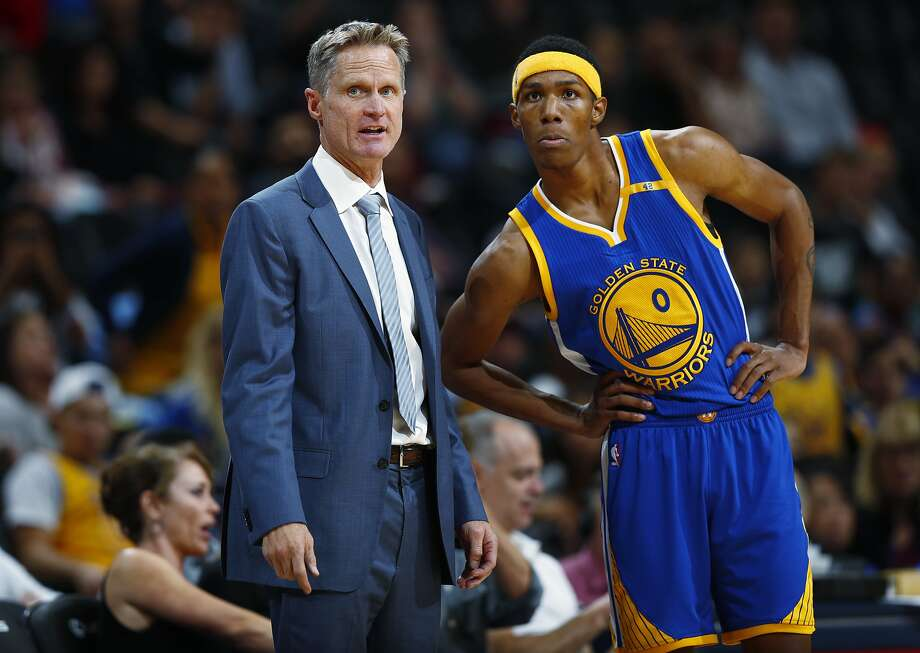 Golden State Warriors coach Steve Kerr, left, confers with guard Patrick McCaw in overtime of an NBA preseason basketball game against the Denver Nuggets on Friday, Oct. 14, 2016, in Denver. The Warriors won 129-128 in overtime. (AP Photo/David Zalubowski) Photo: David Zalubowski, Associated Press