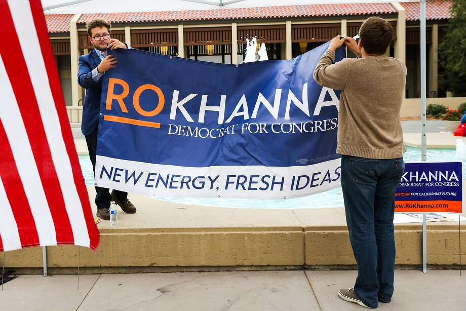 Jake Bleich and Maatthew Jorgens (right) put a poster up before House candidate Ro Khanna speaks at De Anza College in Cupertino. Photo: Gabrielle Lurie, The Chronicle