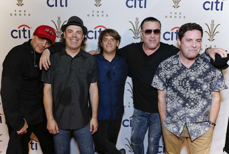 Drummer Randy Cooke (L), bassist Paul De Lisle (2nd from L), keyboard player Michael Klooster (center) and frontman Steve Harwell (2nd from R) of the band Smash Mouth poses for photo at Citi Presents Smash Mouth at The Grove's 2016 Summer Concert Series at The Grove on July 20, 2016 in Los Angeles. Smash Mouth and the Oakland A's got into a Twitter war on Friday.