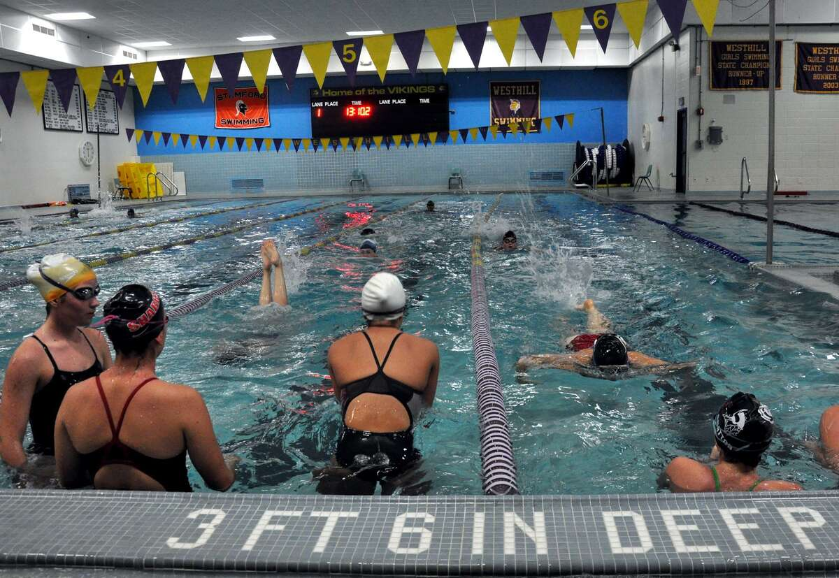 Members of the Westhill-Stamford girls swim team practice in the Westhill High School pool in 2011. The team's coach and asssistant coach were been suspended because of a practice when the pool water had not been properly conditioned.