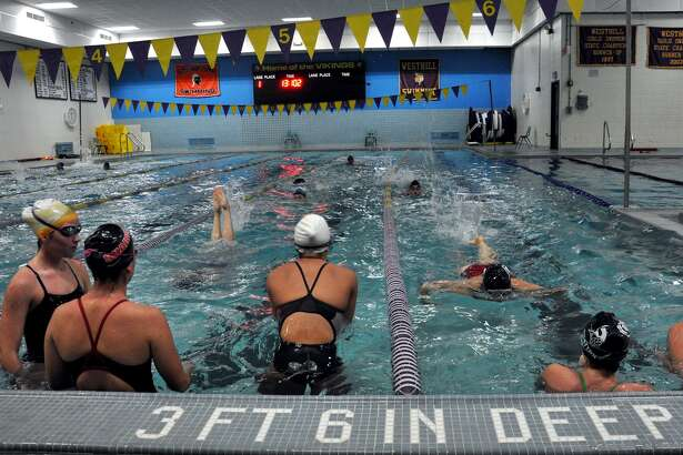 A file photo shows the Westhill-Stamford girls swim team practice. Last week several members of the Westhill-Stamford co-op girls swimming and diving team became sick after practicing in the Westhill pool that did not have any chlorene in it.