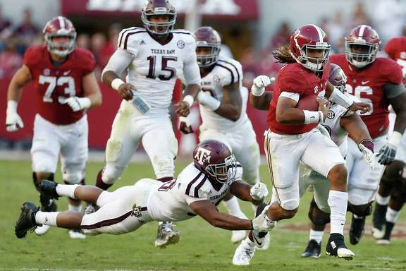 Alabama quarterback Jalen Hurts runs for a 27-yard touchdown against Texas A&M. The Aggies have given up 569 yards rushing the last two games.