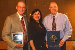Willis McCutcheon (left), president of Happy State Bank in Plainview, received the Texas IOLTA Prime Partner Award for the bank's support of the Interest on Lawyers' Trust Accounts Program (IOLTA). Attorney Don Snodgrass was honored with a Texas Senate Proclamation for his volunteer work with Legal Aid of NorthWest Texas. The recognitions were made Thursday by Betty Balli Torres (center) of Austin, executive director of Texas Access to Justice Foundation.