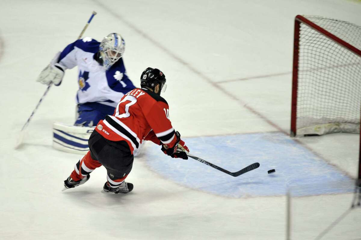 Rod Pelley of the Albany Devils gets the puck past Antoine Bibeau of the Toronto Marlies for the first goal of the game during their American Hockey League quarterfinal playoff series game on Sunday, May 8, 2016, in Albany, N.Y. (Paul Buckowski / Times Union) ORG XMIT: ALB1605082010425469 ORG XMIT: MER2016102715300511