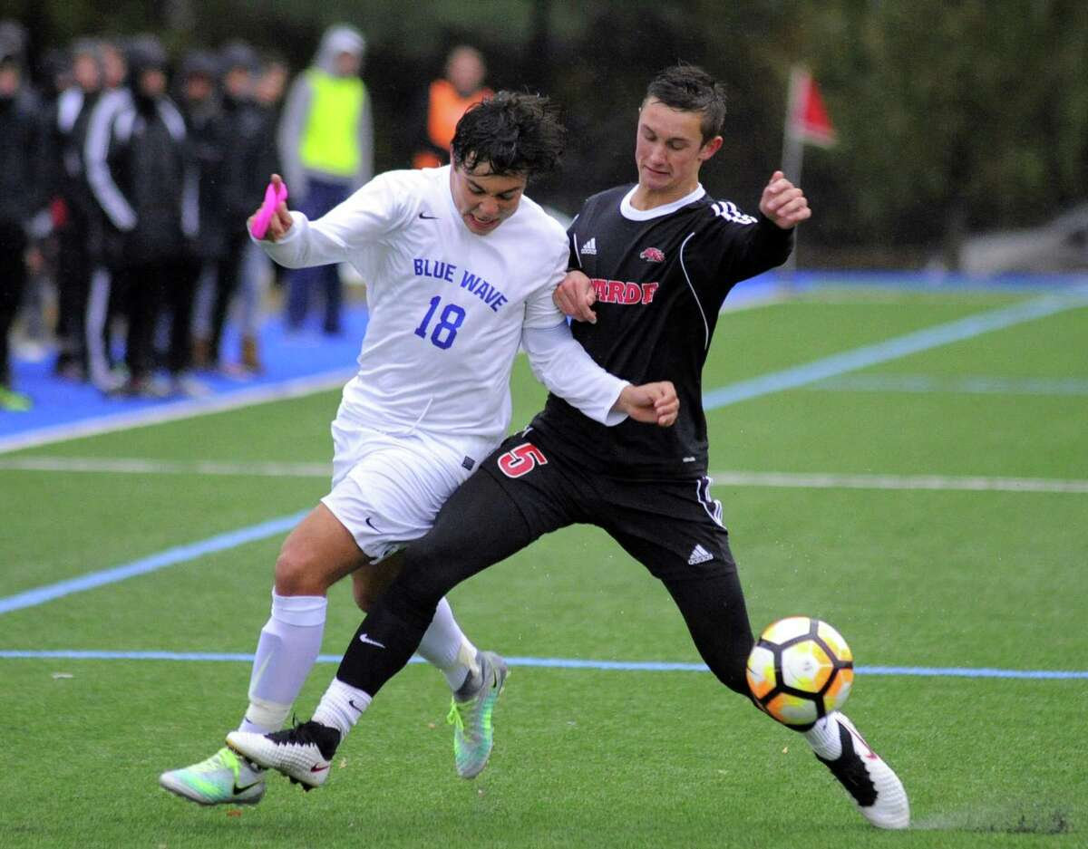Darien Pablo Martinez and Fairfield Warde Jake Otten battle for the ball in a FCIAC Boys Soccer Quarterfinal game in Darien, Conn. on Thursday, Oct. 27, 2016.