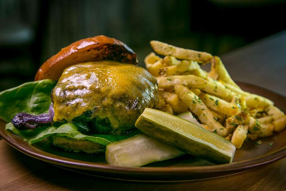 Grass-fed burger with sharp cheddar cheese at Limewood. Photo: John Storey, Special To The Chronicle