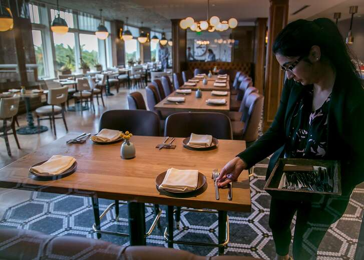 Restaurant manager Sadia Mudassar places silverware for dinner service at Limewood in Berkeley, Calif. on October 27th, 2016.