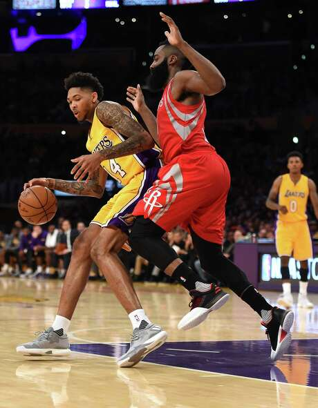 James Harden, right, and the Rockets struggled to consistently slow the Lakers with their one-on-one coverage Wednesday in the season opener. Photo: Harry How, Staff / 2016 Getty Images