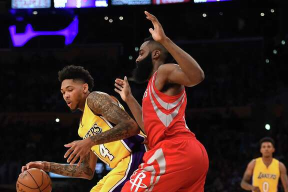 James Harden, right, and the Rockets struggled to consistently slow the Lakers with their one-on-one coverage Wednesday in the season opener.