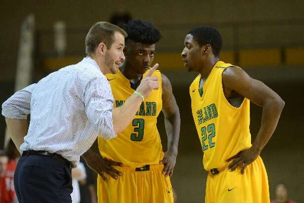 Midland College men's basketball head coach Jordan Dreiling talks with Quay King (3) and Dontay Caruthers (22) during the game against Howard College on Thursday, Jan. 29, 2015 at Chaparral Center.