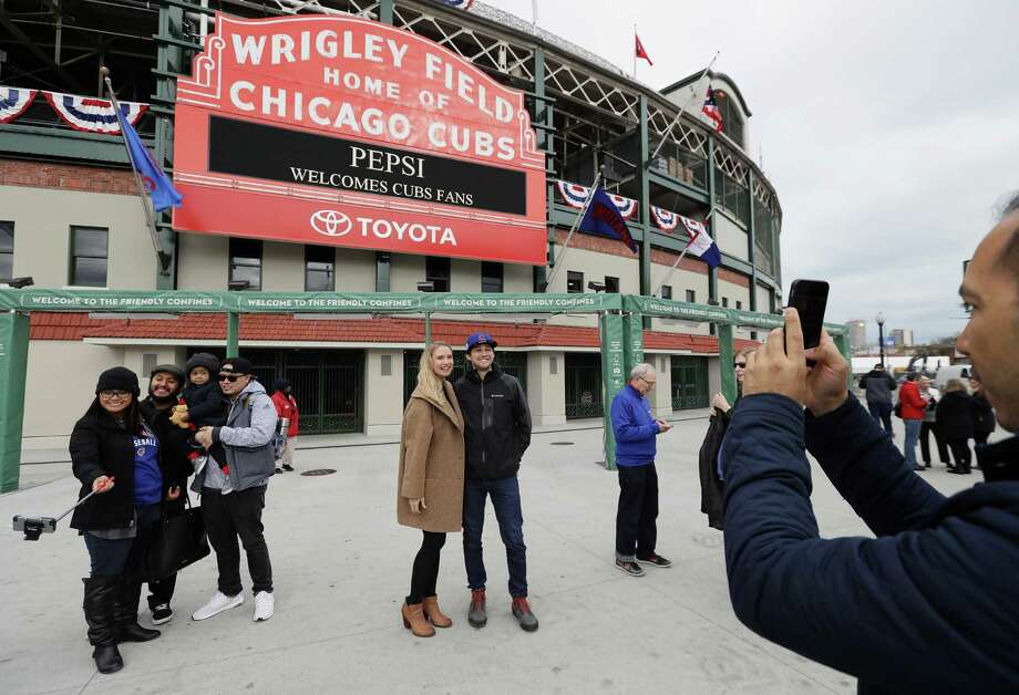 CHICAGO, IL - OCTOBER 27:  Fans take photographs outside of Wrigley Field on October 27, 2016 in Chicago, Illinois. The Chicago Cubs play the Cleveland Indians in game 3 of the World Series on Friday, October 28.  (Photo by Jonathan Daniel/Getty Images) ORG XMIT: 678624539 Photo: Jonathan Daniel / 2016 Getty Images