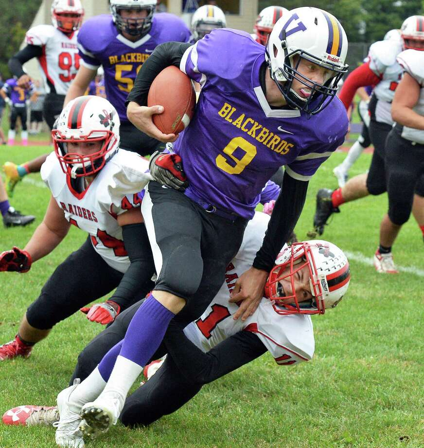 Voorheesville QB #9 Ryan Daly breaks free of Mechanicville defenders during Saturday's game Oct. 1, 2016 in Voorheesville, NY.  (John Carl D'Annibale / Times Union) Photo: John Carl D'Annibale / 40038219A