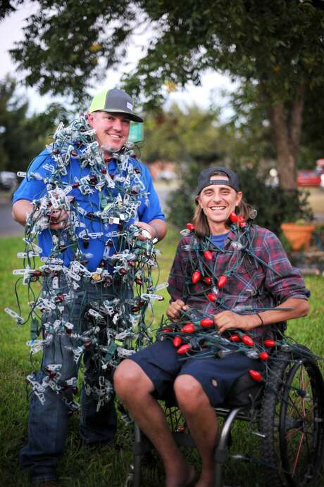 Neighbors Tommy Stavley, left, and Joel Buckingham pose for a photo in late October near their homes on Neely Avenue. The pair are well-known for decorating their houses and front yards for the Christmas holiday with displays featuring music Photo: James Durbin