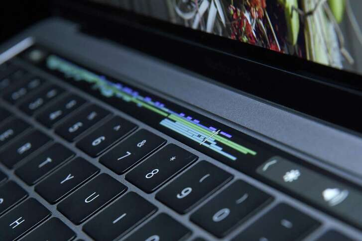 A new MacBook Pro includes the Touch Bar, which replaces function keys across the top of the keyboard. It has functions iPhone users will likely recognize.