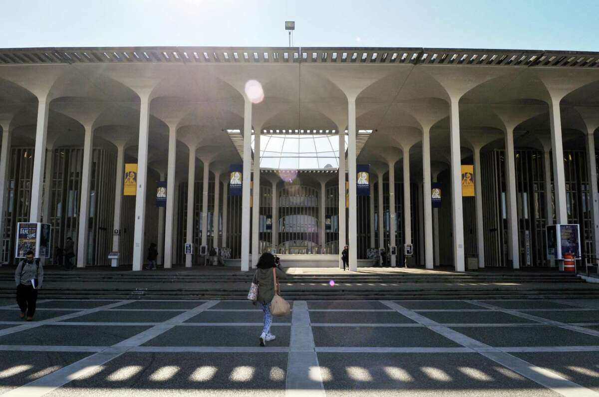 University at Albany students walks in-front of the Campus Center on the UAlbany campus in the afternoon of Friday, Feb. 26, 2016, in Albany, N.Y.