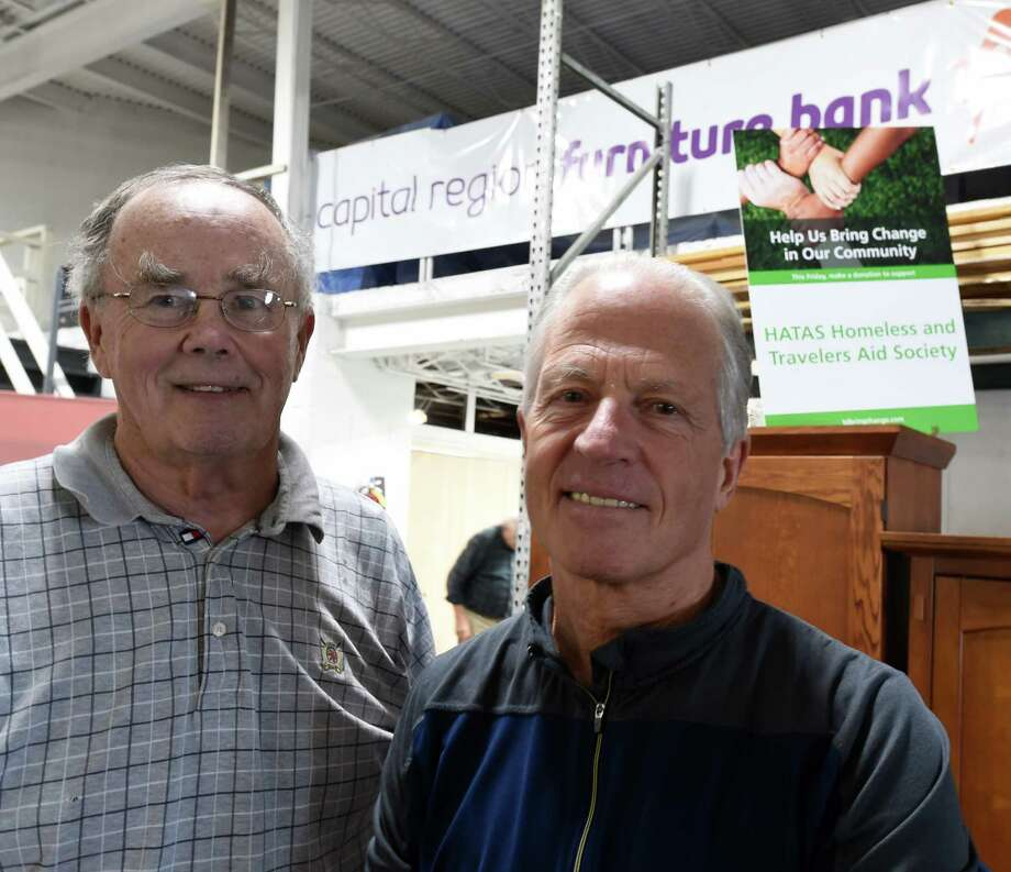 Jack Beckett, program coordinator, left and Pete Newkirk, volunteer and board member at HATAS work at the Capital Region Furniture Bank Thursday Oct. 27, 2016 in Albany, N.Y.  (Skip Dickstein/Times Union) Photo: SKIP DICKSTEIN / 20038582A