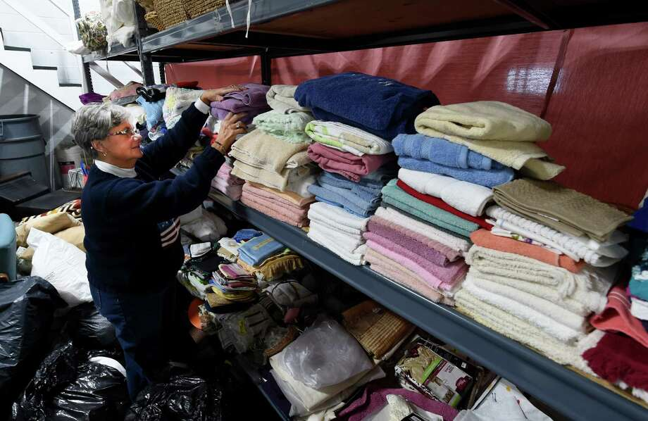 Noreen Thomas, volunteer packs shelves with household items at the Capital Region Furniture Bank Thursday Oct. 27, 2016 in Albany, N.Y.  (Skip Dickstein/Times Union) Photo: SKIP DICKSTEIN / 20038582A