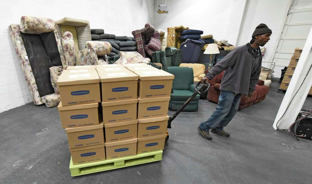 Taurus Whitehead, Warehouse Coordinator Moves Household Items At The  Capital Region Furniture Bank Thursday Oct