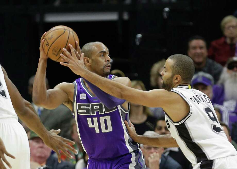 Sacramento Kings guard Arron Afflalo, left, looks to pass against San Antonio Spurs guard Tony Parker during the first quarter of an NBA basketball game in Sacramento, Calif., Thursday, Oct. 27, 2016. (AP Photo/Rich Pedroncelli) Photo: Rich Pedroncelli, Associated Press / Copyright 2016 The Associated Press. All rights reserved.
