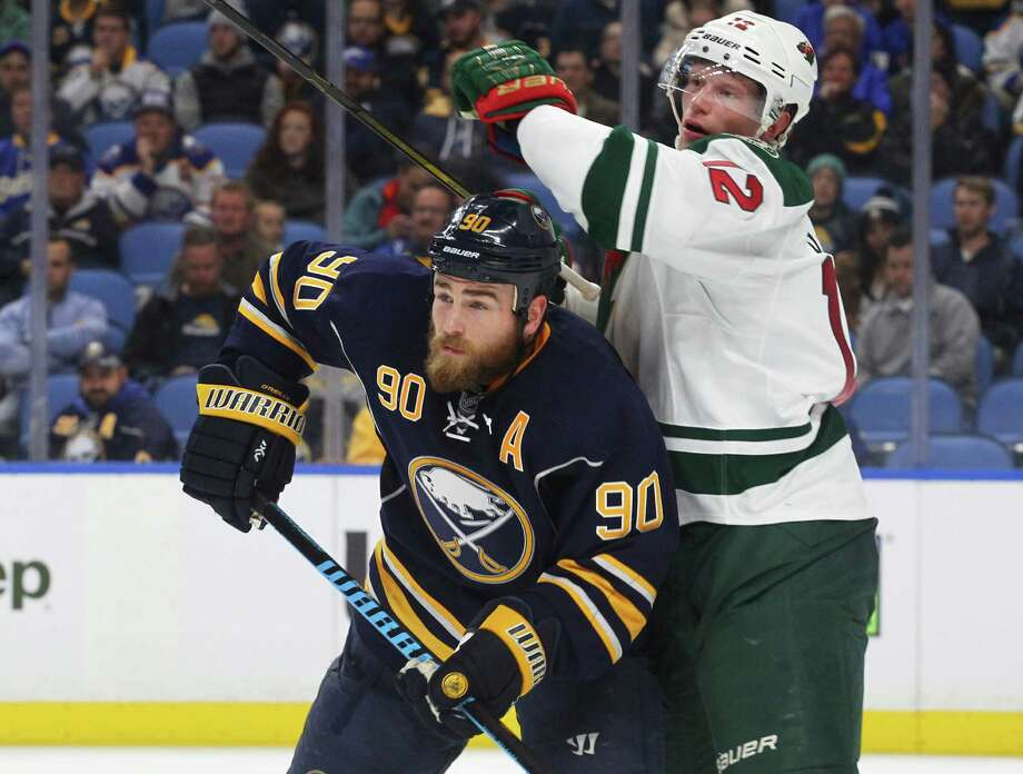 Buffalo Sabres' Ryan O'Reilly and Minnesota Wild's Eric Staal (12) battle for position during the third period of an NHL hockey game, Thursday, Oct. 27, 2016, in Buffalo, N.Y. (AP Photo/Jeffrey T. Barnes) ORG XMIT: NYJB101 Photo: Jeffrey T. Barnes / 2016
