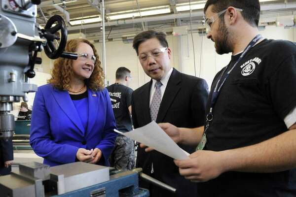Ben MacNicholl, 17, right, explains his work in the manufacturing technology department of Abbott Tech to U.S. Rep Elizabeth Esty and Deputy Labor Secretary Chris Lu during a 2015 visit highlighting a then-new manuafacturing partnership between Abbott Tech and Naugatuck Valley Community College's Danbury campus.