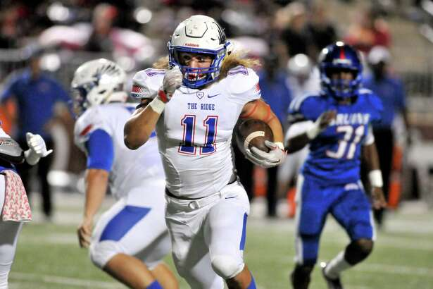 Conroe Oak Ridge running back Grant Stuard breaks through the West Brook defense on his way to a 31-yard touchdown run in the first quarter of their game Thursday night at the Thomas Center in Beaumont. (Mike Tobias/The Enterprise)