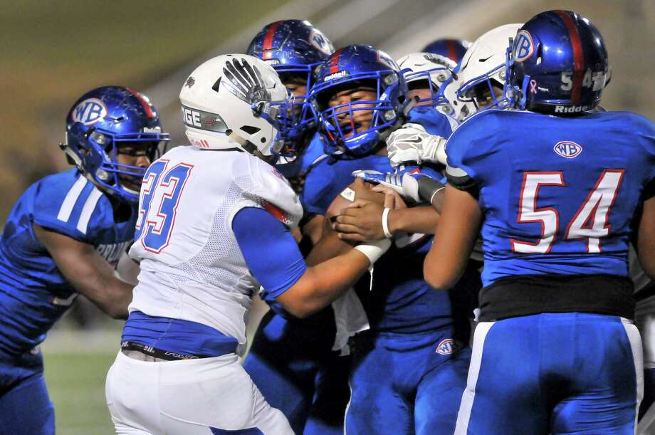 West Brook running back Joel Denley, center, fights through a group of Conroe Oak Ridge defenders and Bruin linemen during the first quarter of Thursday's game at the Thomas Center in Beaumont. (Mike Tobias/The Enterprise) Photo: Mike Tobias/The Enterprise