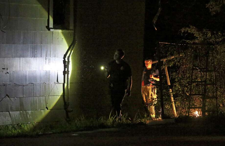 Fire fighters inspect the structure after a fire in the back of a home in the 600 block of Gulf Street on the East Side takes the life of an infant inside on October 27, 2016.  The parents were not at home during the occurrence of the fire. Photo: Tom Reel, San Antonio Express-News / 2016 SAN ANTONIO EXPRESS-NEWS