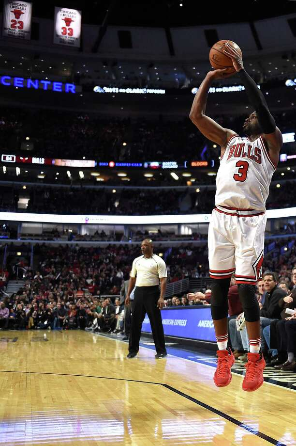 CHICAGO, IL - OCTOBER 27:  Dwyane Wade #3 of the Chicago Bulls takes a three-point shot during the second half of a game against the Boston Celtics at the United Center on October 27, 2016 in Chicago, Illinois. NOTE TO USER: User expressly acknowledges and agrees that, by downloading and or using this photograph, User is consenting to the terms and conditions of the Getty Images License Agreement.  (Photo by Stacy Revere/Getty Images) ORG XMIT: 662351647 Photo: Stacy Revere / 2016 Getty Images