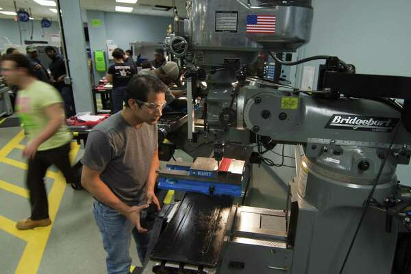 Housatonic Community College student Chantha Yok, of New Haven, works on a Bridgeport milling machince at the school's Advanced Manufacturing program in Bridgeport, Conn. on Thursday Oct. 27, 2015.