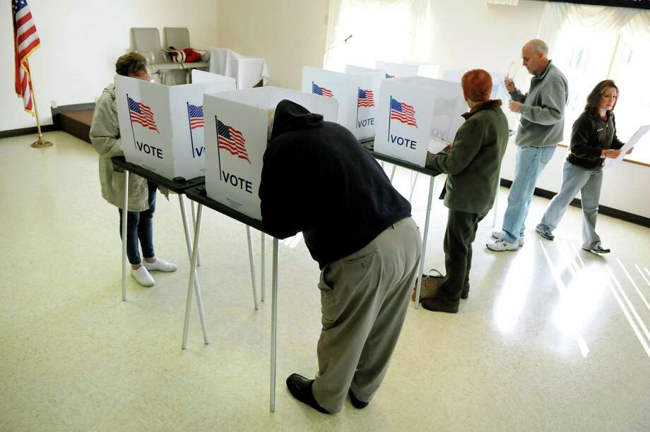 Voters fill out their ballots on Tuesday, Nov. 6, 2012, at the American Legion Post in Halfmoon, N.Y. (Cindy Schultz / Times Union archive) Photo: Cindy Schultz