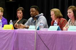 Willis ISD school board member candidates for position 2 and 6 take part in a forum Thursday.