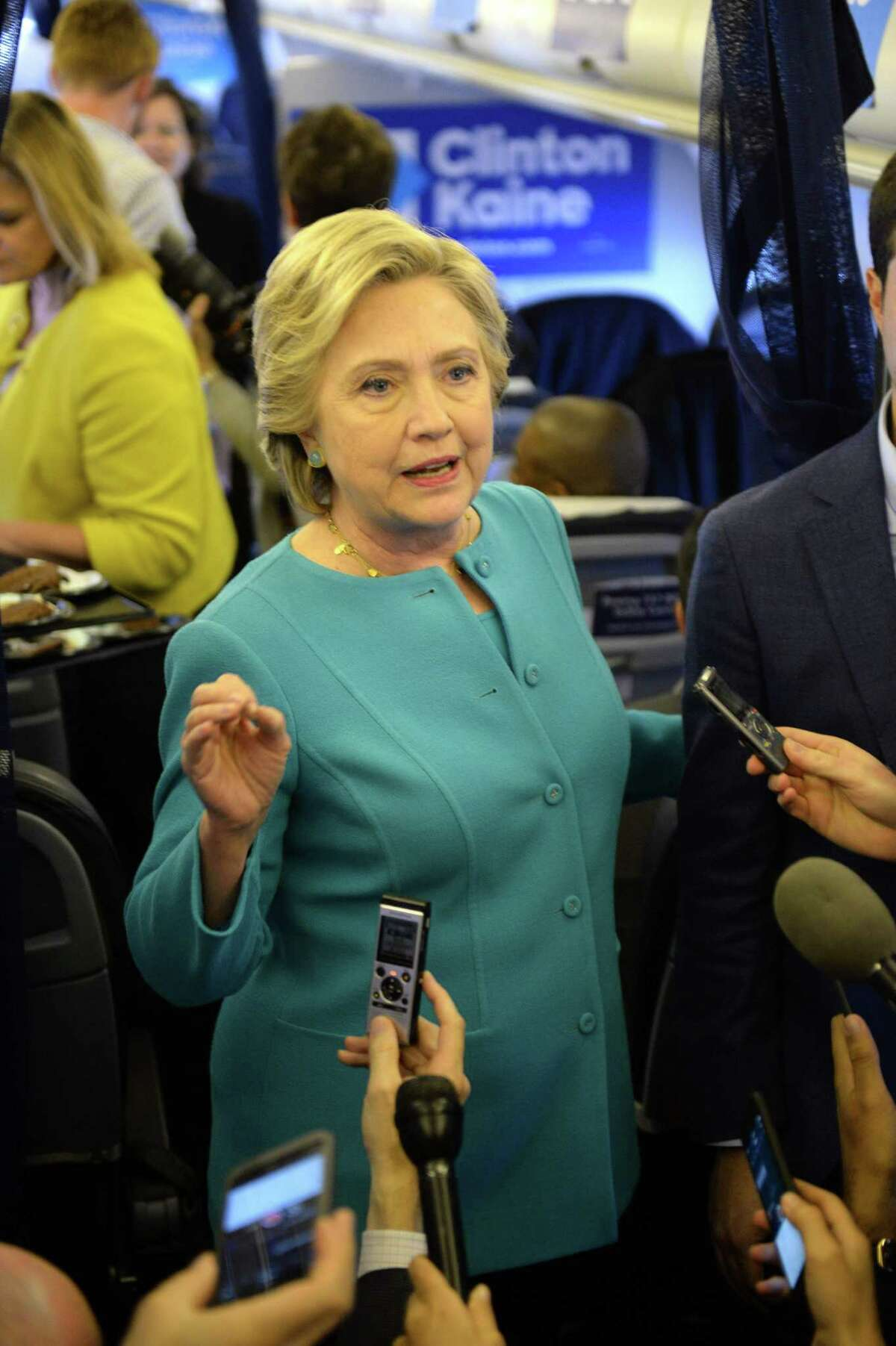 Democratic presidential nominee Hillary Clinton talks with the press on her plane while en-route from Tampa, Florida to Laguardia Airport in New York, October 26, 2016. / AFP PHOTO / Robyn BECKROBYN BECK/AFP/Getty Images