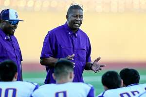 Brackenridge coach Willie Hall talks to his team before the start of a District 28-5A game agaisnt Lanier at Alamo Stadium on Oct. 27, 2016.
