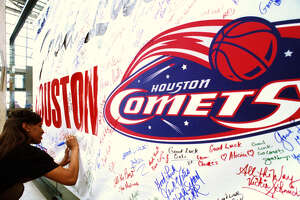 Jacqueline Moreland signs a 'good luck' banner for the Comets at the Parks Shops.   HOUCHRON CAPTION (08/21/1998):  As the Comets prepare to open the WNBA playoffs against Charlotte on Saturday, they are getting plenty of support from fans like Jacqueline Moreland, who stopped by to sign the spirit banner at the Park Shops at Houston Center.