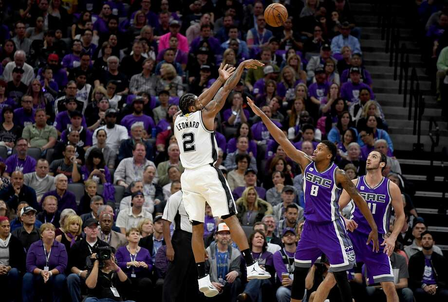 SACRAMENTO, CA - OCTOBER 27:  Kawhi Leonard #2 of the San Antonio Spurs shoots over Rudy Gay #8 of the Sacramento Kings during the first quarter of an NBA basketball game at Golden 1 Center on October 27, 2016 in Sacramento, California. NOTE TO USER: User expressly acknowledges and agrees that, by downloading and or using this photograph, User is consenting to the terms and conditions of the Getty Images License Agreement.  (Photo by Thearon W. Henderson/Getty Images) Photo: Thearon W. Henderson/Getty Images