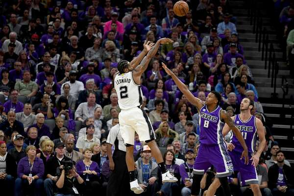 SACRAMENTO, CA - OCTOBER 27:  Kawhi Leonard #2 of the San Antonio Spurs shoots over Rudy Gay #8 of the Sacramento Kings during the first quarter of an NBA basketball game at Golden 1 Center on October 27, 2016 in Sacramento, California. NOTE TO USER: User expressly acknowledges and agrees that, by downloading and or using this photograph, User is consenting to the terms and conditions of the Getty Images License Agreement.  (Photo by Thearon W. Henderson/Getty Images)