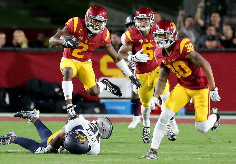 USC defensive back Adoree Jackson hurdles over Cal cornerback Chibuzo Nwokocha on a punt return in the first quarter on Thursday, Oct. 27, 2016, at the Los Angeles Memorial Coliseum. (Luis Sinco/Los Angeles Times/TNS) Photo: Luis Sinco, TNS