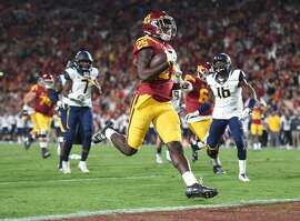 LOS ANGELES, CA - OCTOBER 27:  Running back Ronald Jones II #25 of the USC Trojans scores a touchdown to take a 14-0 lead over the California Golden Bears during the first quarter at Los Angeles Coliseum on October 27, 2016 in Los Angeles, California.  (Photo by Harry How/Getty Images)