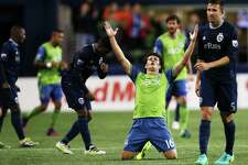 Nelson Valdez (16) celebrates the Sounders 1-0 victory over Sporting Kansas City in their Western Conference Knockout Round playoff game, Thursday, Oct. 27, 2016.  Valdez scored the winning goal.