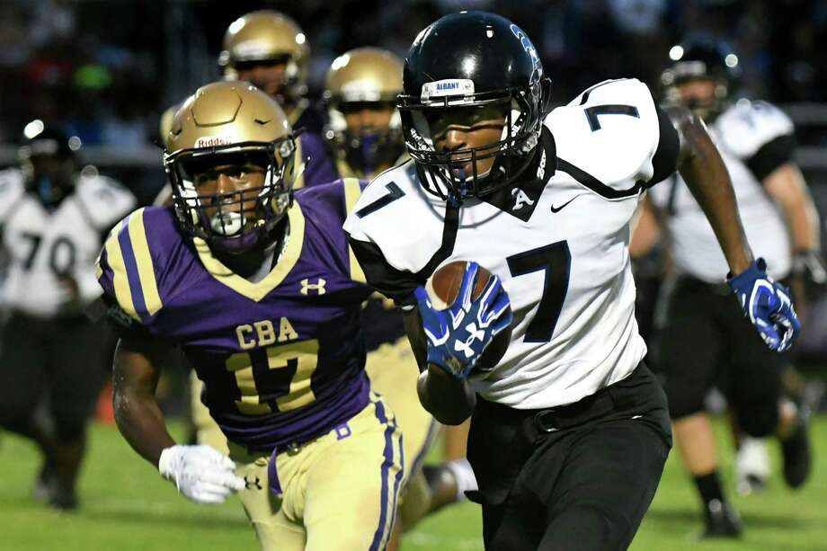 Albany's Jarrell Chaney, right, carries the ball as CBA's Jarrell Young defends during their football game on Friday, Sept. 9, 2016, at Christian Brothers Academy in Colonie, N.Y. (Cindy Schultz / Times Union) Photo: Cindy Schultz / Albany Times Union