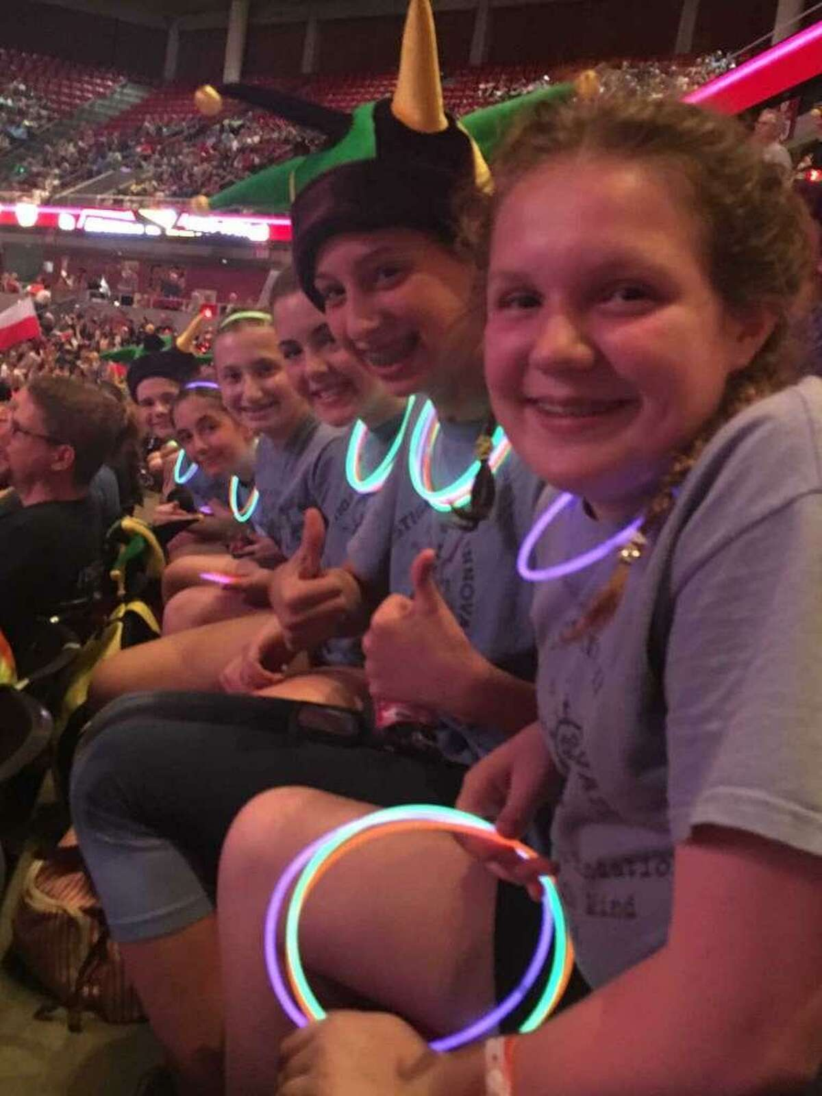 FILE - From left, Julia Kempton, Annalise Fabricator, Meredith Ford, Abby Guttman, Emily Sasser and Alba Alizoti pose in their team t-shirts at Odyssey of the Mind World Finals at Iowa State University.